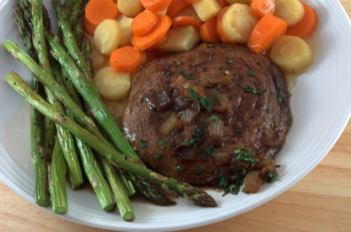 portobello mushroom steak with asparagus and carrots on a plate