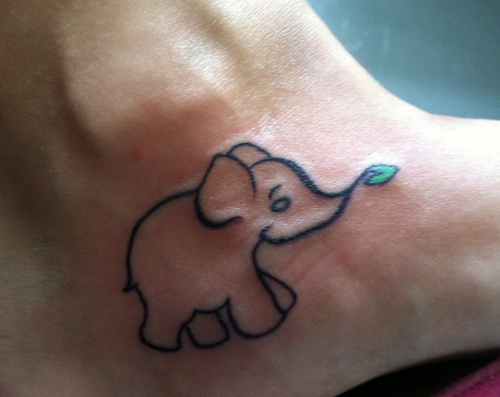 tattoo of an elephant eating a green leaf on LIndsay's foot