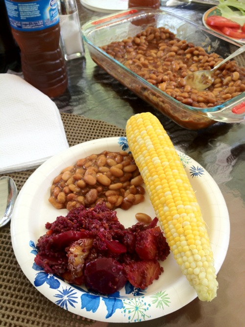 plate with baked beans and an ear of corn