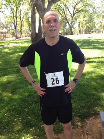 man in running clothing with marathon number attached to his stomach