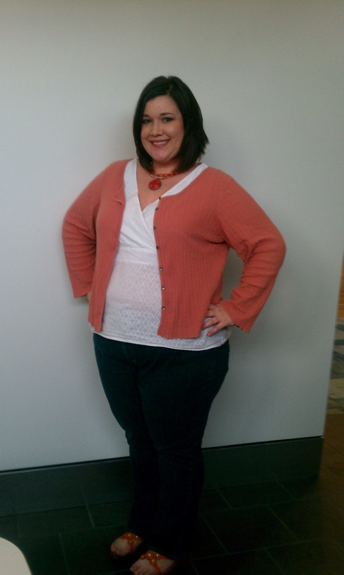 overweight woman wearing white shirt with orange sweater