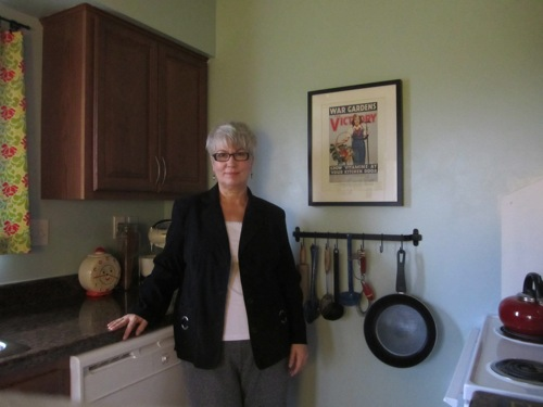 image of same woman standing in kitchen after losing 60 pounds