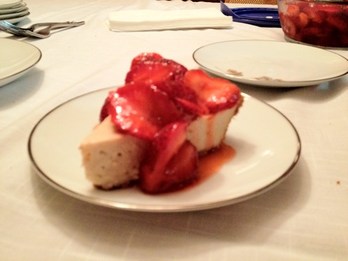 vegan cheesecake topped with strawberries